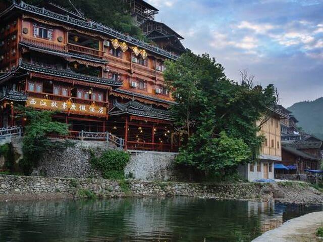 Khách sạn Xijiang Gushi Holiday.